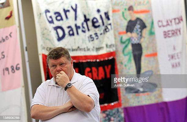 A visitor views panels of the AIDS Memorial Quilt that are being displayed on February 13 2012 in San Francisco California 312 panels of the AIDS...