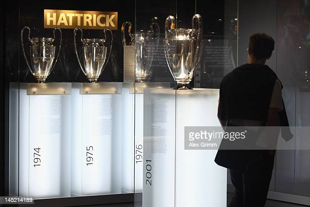 Visitor views the 2001 Champions League trophy during the presentation of the 'Bayern Muenchen Erlebniswelt' at Allianz Arena on May 24, 2012 in...
