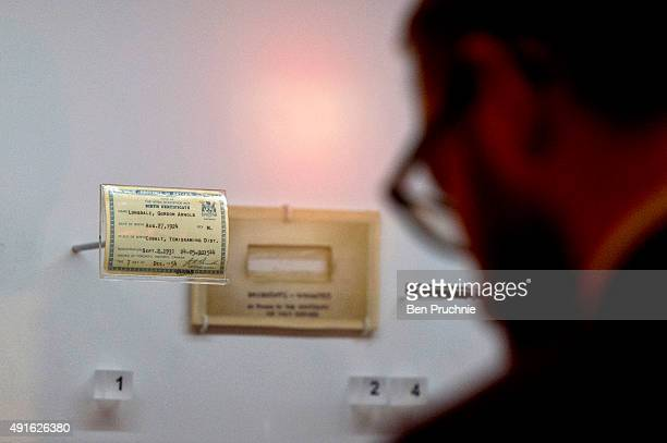 A visitor views the birth certificate of Gordon Lonsdale at the 'Met Crime Museum Uncovered' exhibition on October 7 2015 in London England Running...