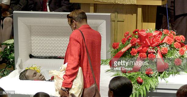 A visitor views the body of Timothy Thomas at his funeral April 14 2001 in Cincinnati OH A white Cincinnati police officer shot and killed Thomas...