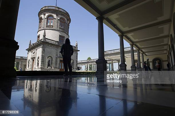 A visitor views the center tower of the Chapultepec Castle which houses Mexico's National Museum of History in Mexico City Mexico on Friday Oct 14...
