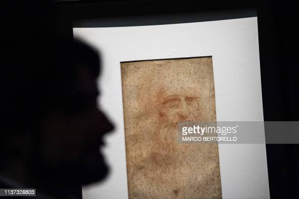 A visitor views the Portrait of a man in red chalk widely accepted as a self portrait of Leonardo da Vinci during the exhibition Leonardo da Vinci...