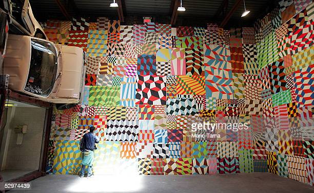 A visitor views the urban street art installation 'One More Thing' by artist Barry McGee May 24 2005 in New York City The installation features found...