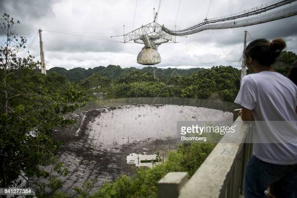 A visitor views the world's largest single dish radio telescope at the Arecibo Observatory in Arecibo Puerto Rico on Friday Aug 25 2017 Over the...