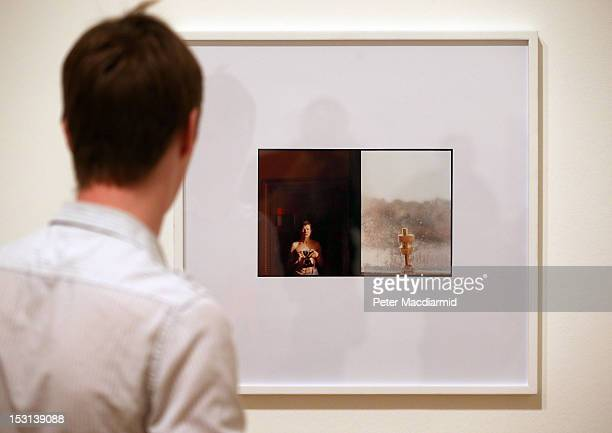 A visitor views Turner Prize nominee Luke Fowler's 'Self Portrait with Window 2011' on display at Tate Britain on October 1 2012 in London England...