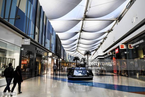Visitor walk through a shopping arcade at the Dolce Vita Tejo shopping mall operated by AXA Real Estate Investment Managers SGR SpA in Lisbon...