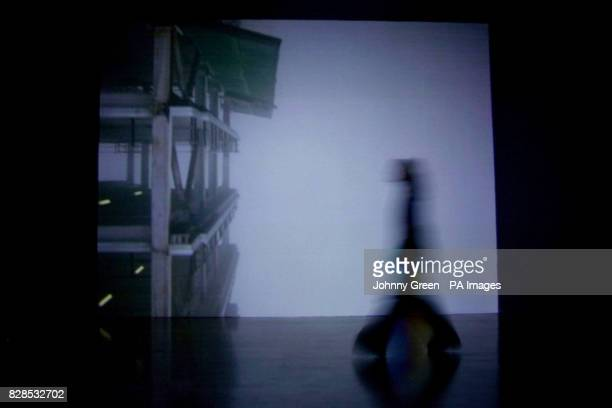 A visitor walks across Turner Prize 2002 nominee Catherine Yass' 'Descent' inside the Tate Britain in central London 'Descent' one of two films in...