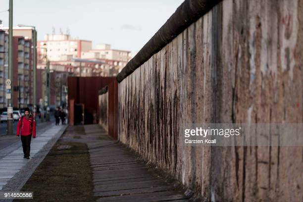 A visitor walks along the Berlin Wall memorial at Bernauer Strasse on February 5 2018 in Berlin Germany Today has been 10316 days since the Berlin...