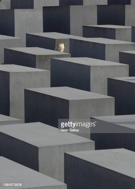A visitor walks among stellae at the Monument to the Murdered Jews of Europe also called the Holocaust Memorial prior to the 80th anniversary of the...