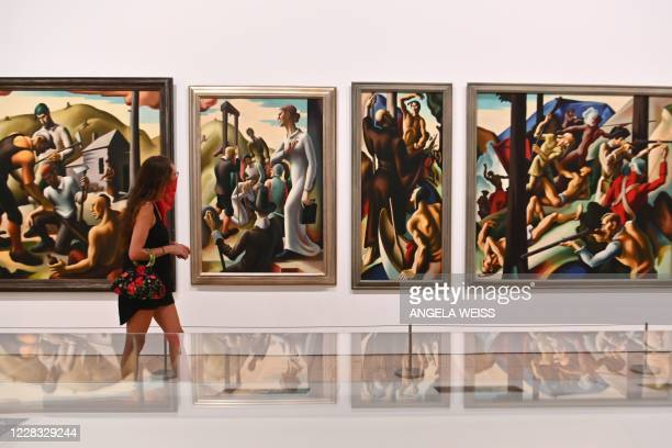 Visitor walks by paintings at the newly reopened Whitney Museum of American Art on September 3, 2020 in New York City. - The museum officially opened...