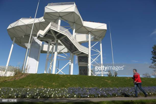A visitor walks by the Wolkenhain elevated structure during the IGA International Garden Exhibition on April 13 2017 in Berlin Germany The showcase...