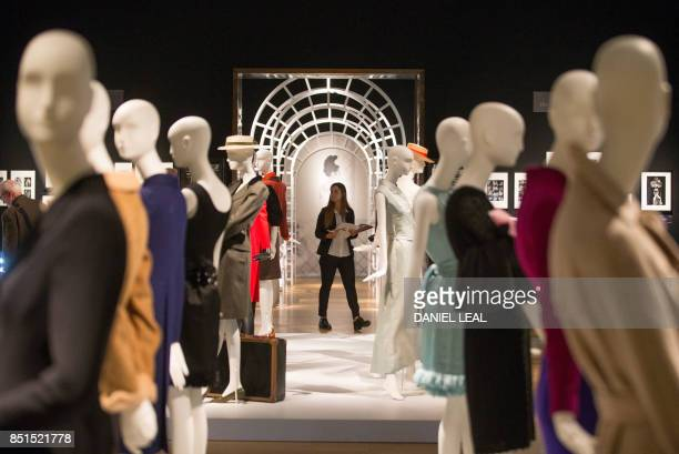A visitor walks during a preview of Audrey Hepburn's personal collection at Christie's auction house in central London on September 22 2017 / AFP...