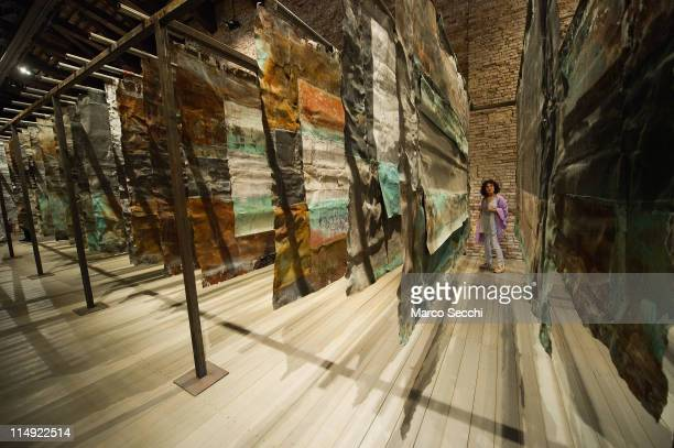 A visitor walks next to the panels of the installation 'Salt of the Eart' by Anselm Kiefer during the press preview of the exhibition on May 29 2011...