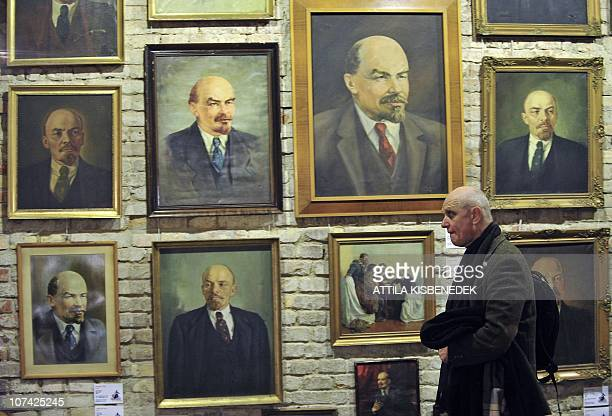 A visitor walks on December 4 2010 past communistera relics on show at the Pinter Gallery in Budapest More than 200 communistera relics found by the...