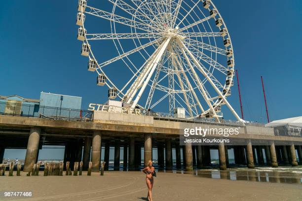 A visitor walks on the beach on June 29 2018 in Atlantic City New Jersey Two new casinos opened this week in the seaside resort as residents seek an...