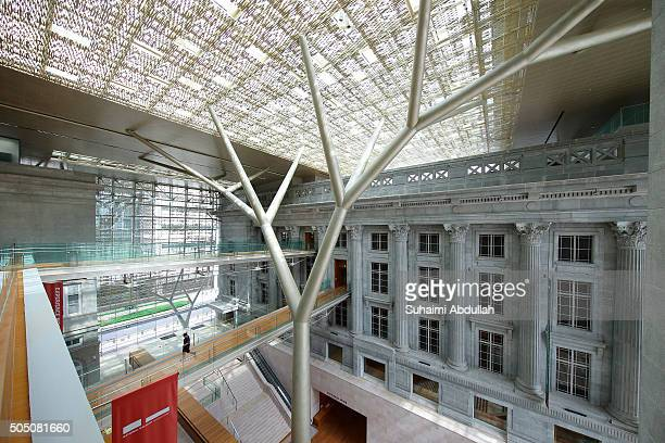 A visitor walks on the lower link bridge that connects City Hall and former Supreme Court at the National Gallery on January 15 2016 in Singapore The...