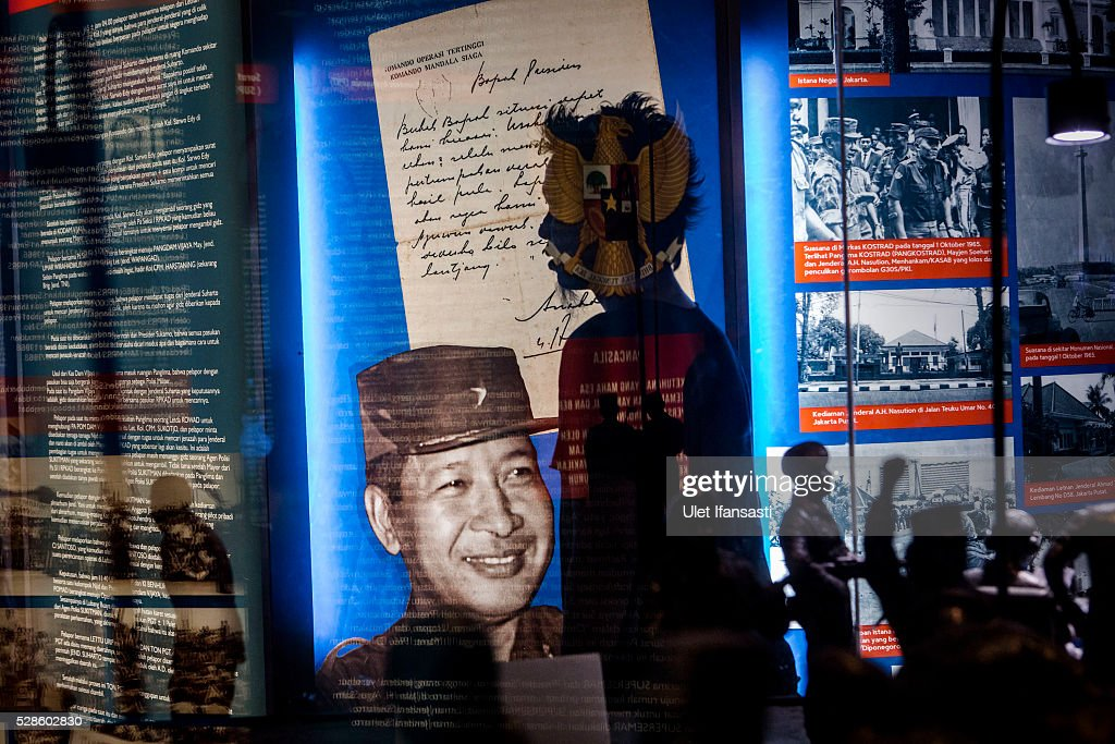 A visitor walks pass a picture of Soeharto at Soeharto museum on May 06, 2016 in Yogyakarta, Indonesia. Survivors of Indonesia's anti-communist massacres in 1965 called for investigations on the country's purges, in which hundreds of thousands of people are believed to have been killed by the Indonesian military when the Cold War was escalating in Southeast Asia. Based on human rights groups, half a million people died in 1965 during a massacre carried out by the military and religious groups after an attempted coup by suspected communists, where an officer-led group kidnapped and executed six generals on the night of Septemeber 30, 1965. Known as one of the worst mass atrocities of the 20th century, many among the dead had no connection to Communism, and hundreds of thousands had been held in dentention centers for years during the period.