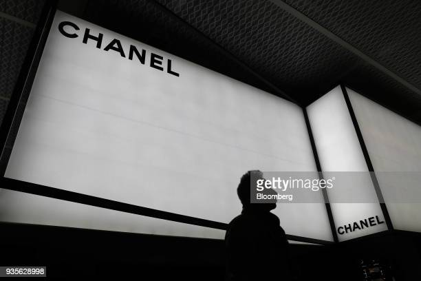 A visitor walks past a Chanel SA luxury goods booth during the opening day of the 2018 Baselworld luxury watch and jewelry fair in Basel Switzerland...