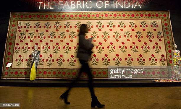 A visitor walks past a floorspread during a press preview of 'The Fabric of India' exhibition at the Victoria and Albert Museum in London on...