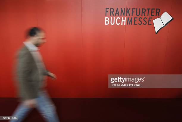 Visitor walks past a logo of the Frankfurt Book Fair October 14, 2008. Turkey is guest of honour at the 60th edition of the book fair, which takes...