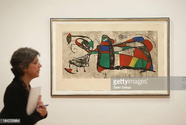 A visitor walks past a painting by Joan Miro at the From Beckmann To Warhol Art of the 20th and 21st Centuries The Bayer Collection exhibition during...