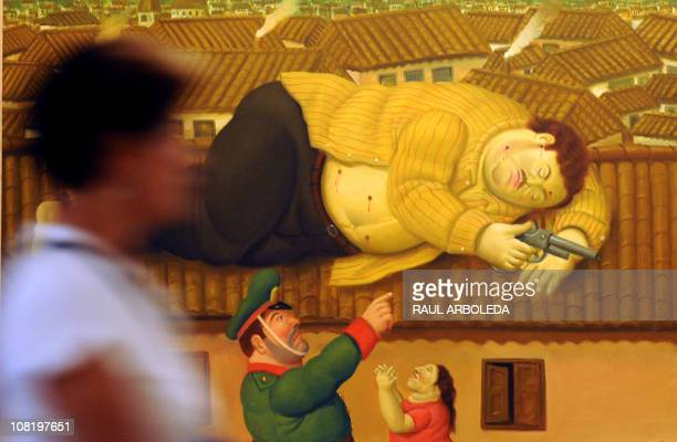 A visitor walks past a painting named Dead Pablo Escobar by Colombian Artist Fernando Botero displayed at the Antioquia Museum in Medellin Antioquia...