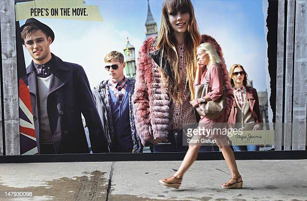 A visitor walks past a Pepe billboard at the 2012 Bread Butter fashion trade fair at former Tempelhof Airport on July 6 2012 in Berlin Germany Bread...