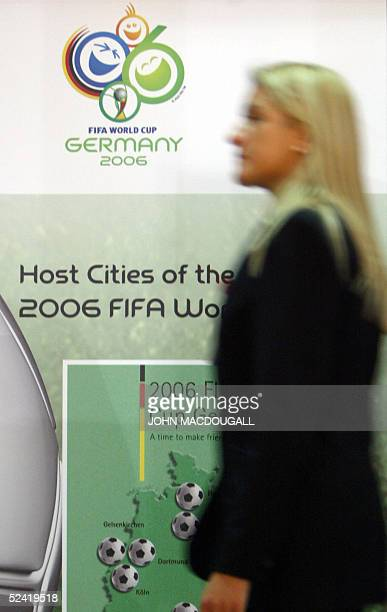 A visitor walks past a poster advertising the 2006 Football World Cup hosted by Germany at Berlin's International Tourism Fair 15 March 2005 With...