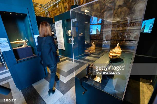A visitor walks past a reproduction of Greek scientist Archimedes' 'endless screw' during the 'Archimedes art and science of the inventor' exhibition...