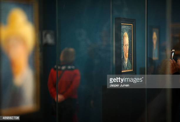 A visitor walks past a self portrait of Dutch PostImpressionist painter Vincent van Gogh on the ground floor of the Vincent van Gogh museum on...