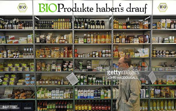 A visitor walks past a shelf displaying organic 'bio' food products at the International Green Week Food and Agriculture Trade Fair in Berlin January...