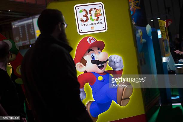 A visitor walks past a Super Mario logo at a Nintendo Co Ltd stand at the EGX 2015 video gaming conference in Birmingham UK on Thursday Sept 24 2015...