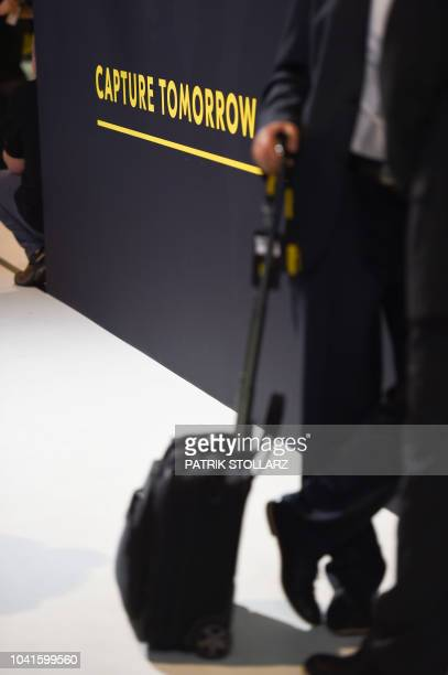 A visitor walks past an advertising at the Nikon stand at the Photokina trade fair in Cologne western Germany on September 27 2018 The fair for the...