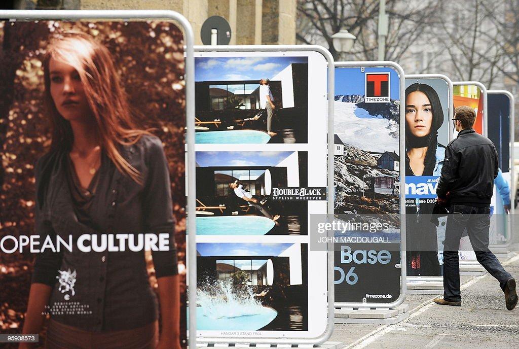 A visitor walks past billboards advertis : News Photo