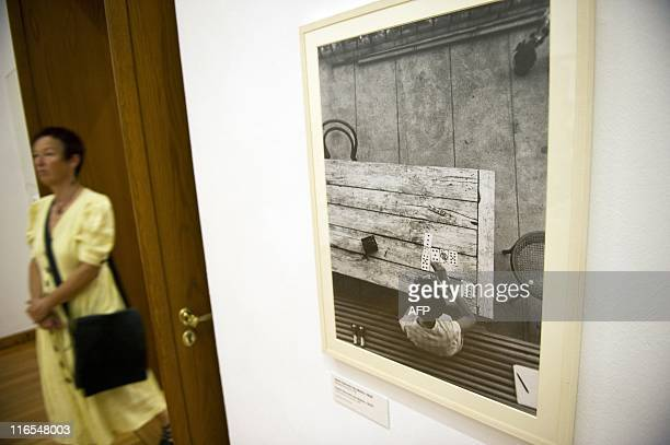 A visitor walks past Hungarianborn US photographer Andre Kertesz' Saint Gervais les Bains 1929 at the Kertesz retrospective at Berlin's...