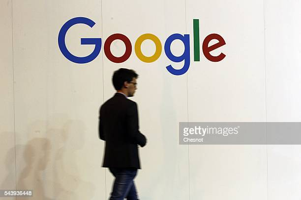 A visitor walks past in front of a Google logo during the Viva Technology show on June 30 2016 in Paris France Viva Technology Startup Connect the...