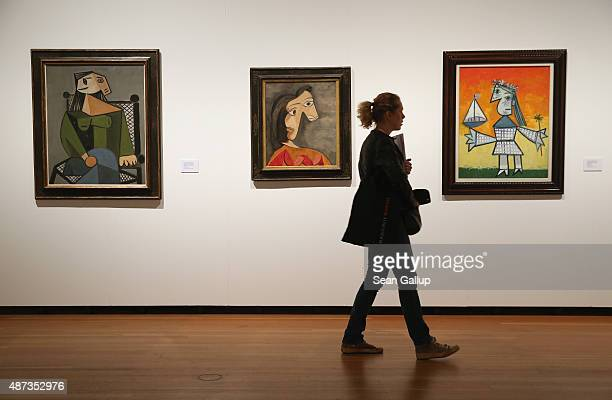 A visitor walks past paintings by Pablo Picasso during a preview for foreign journalists at the Von Hockney bis Holbein die Sammlung Würth exhibition...