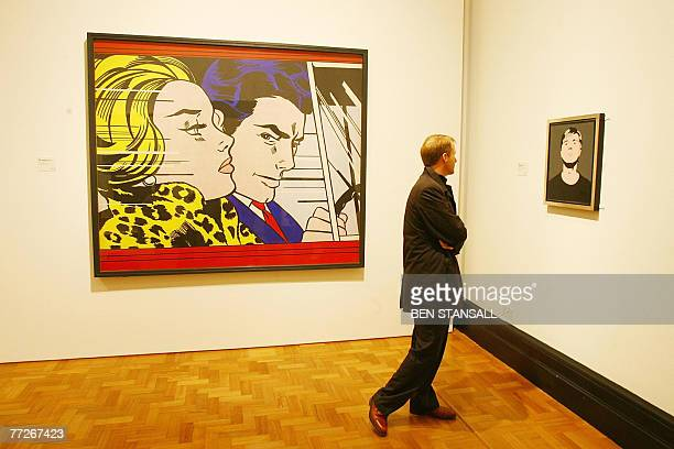 A visitor walks past Roy Lichtenstein's 'In the car 1963' at the Pop Art Portraits exhibition National Portrait Gallery in central London 11 October...
