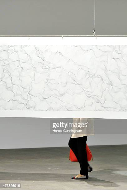 A visitor walks past the artwork ' Il movimento delle cose' by Dadamaino during Art Basel on June 16 2015 in Basel Switzerland Art Basel one of the...