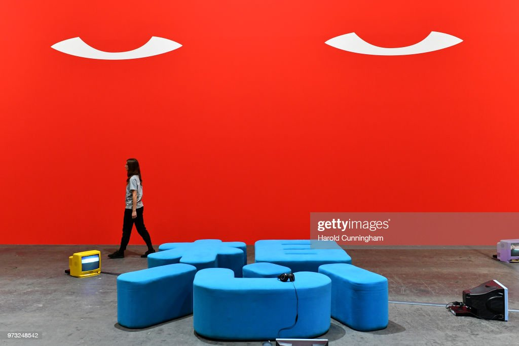 A visitor walks past the artwork of Nedko Solakov 'I miss Socialism, maybe...' during the press preview for Art Basel at Basel Messe on June 13, 2018 in Basel, Switzerland. Art Basel is one of the most prestigious art fair in the world showcasing the work of more than 4,000 artists selected by 300 leading art galleries.