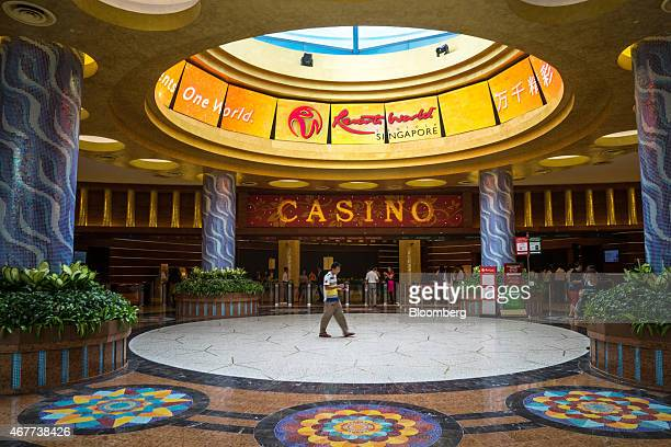 A visitor walks past the casino at Resorts World Sentosa operated by Genting Singapore Plc in Singapore on Thursday March 26 2015 Companies ranging...