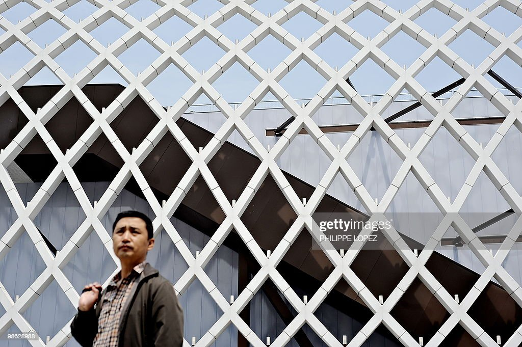 A visitor walks past the French pavilion at the site of the World Expo 2010 in Shanghai on April 23, 2010. Expo organisers gave members of the public a preview of the largest-ever World's Fair as they tested facilities and public transportation before the official start on May 1.