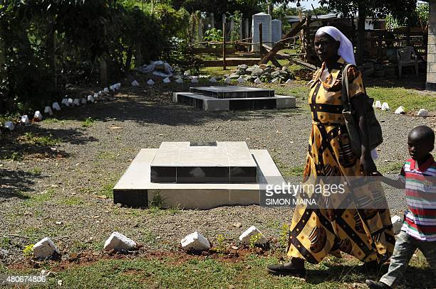 A visitor walks past the graves site of Barack Obama senior at the homestead of Sarah Onyango Obama US President Barack Obama step grandmother on...