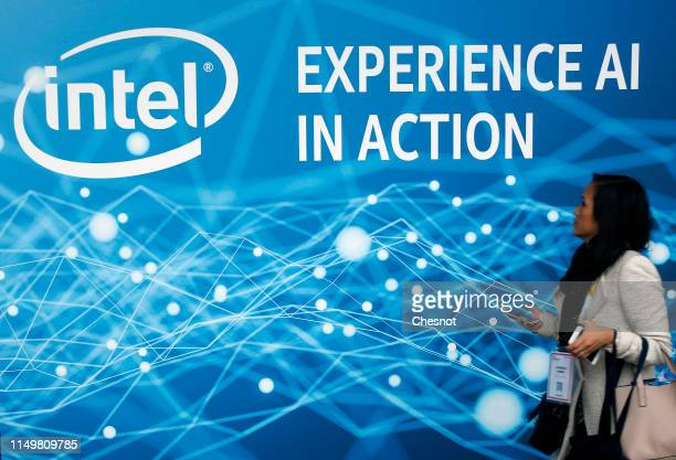 Visitor walks past the logo of the US semiconductor manufacturer Intel during the 4th edition of the Viva Technology show at Parc des Expositions...