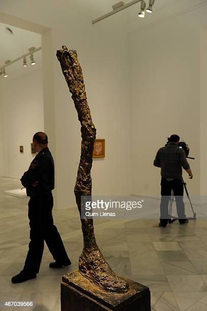 A visitor walks past the sculpture 'La jambe' by Alberto Giacometti during the opening for the press of the exhibition 'Fuego blanco' on loan from...