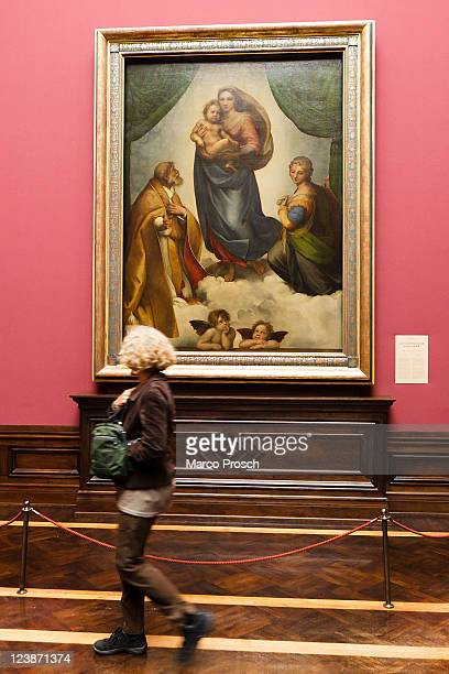 Visitor walks past The Sistine Madonna at the opening of the exhibition 'Himmlischer Glanz' with Raffaelo 'Raffael' Santi's paintings 'The Sistine...