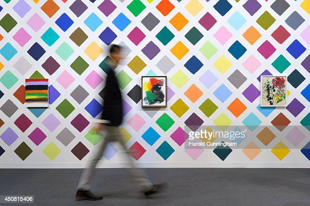 A visitor walks past to the artworks by Martin Creed in the gallery section of Art Basel on June 18 2014 in Basel Switzerland Art Basel one of the...