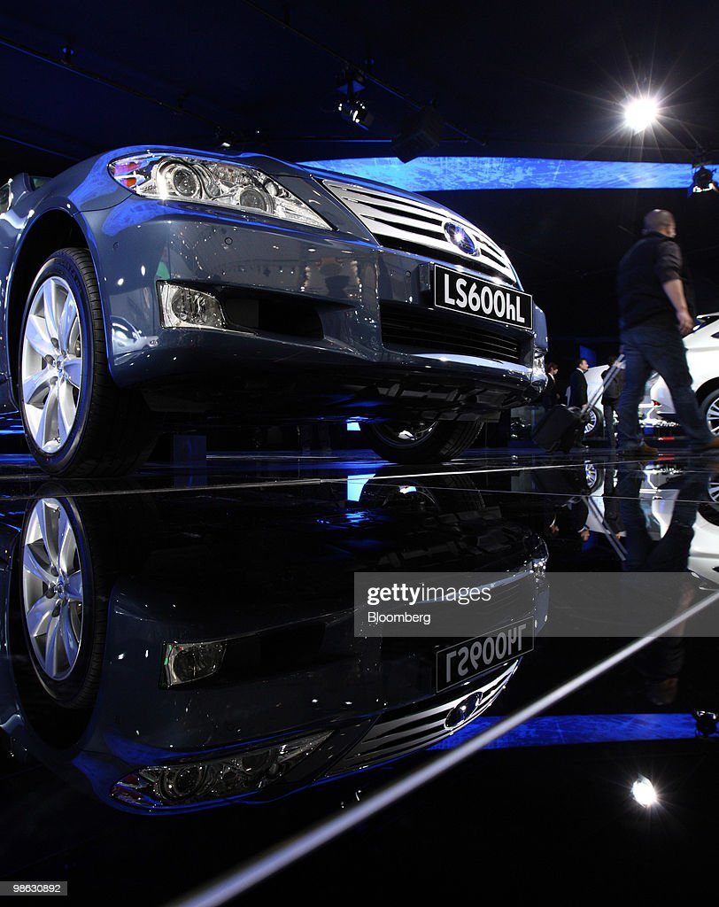 A visitor walks past Toyota Motor Corp.'s Lexus LS 450h hybrid vehicle, displayed at the Beijing Auto Show in Beijing, China, on Friday, April 23, 2010. The show will be held through April 27. Photographer: Tomohiro Ohsumi/Bloomberg via Getty Images