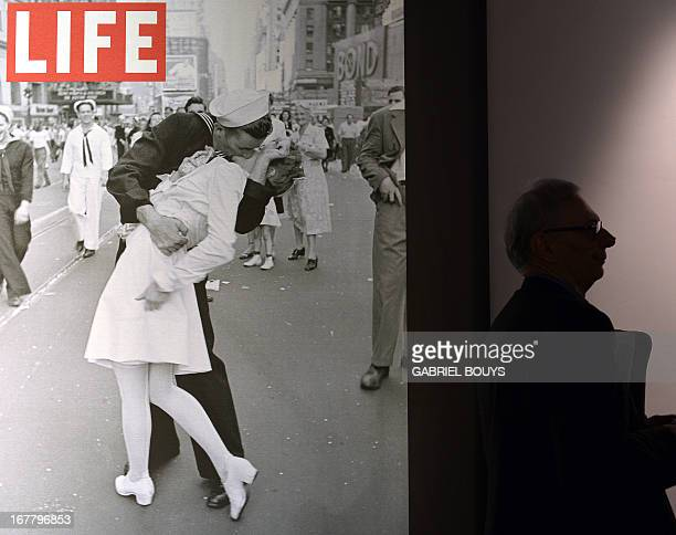 A visitor walks past 'VJ Day a Times Square New York NY 1945' by Alfred Eisenstaedt during the 'Life I grandi fotografi' exhibition at the auditorium...