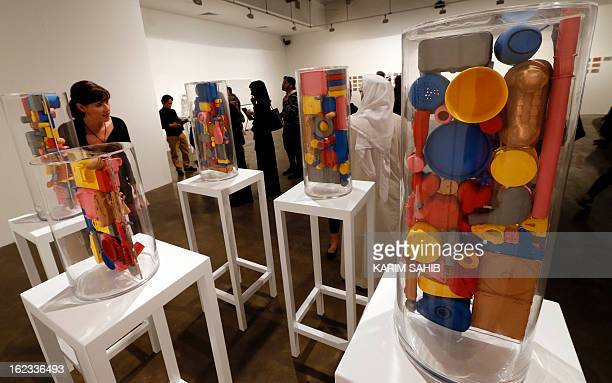 A visitor walks past work by Emirati digital artist Ebtisam Abdulaziz on display during part of an exhibition titled Autobiography 2012 in Dubai on...